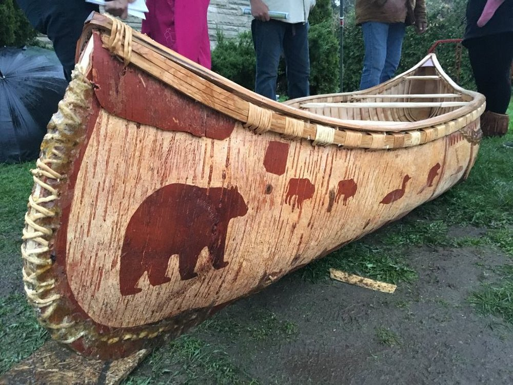 Chuck Commanda's birchbark canoe decorated with bears and other wild animals